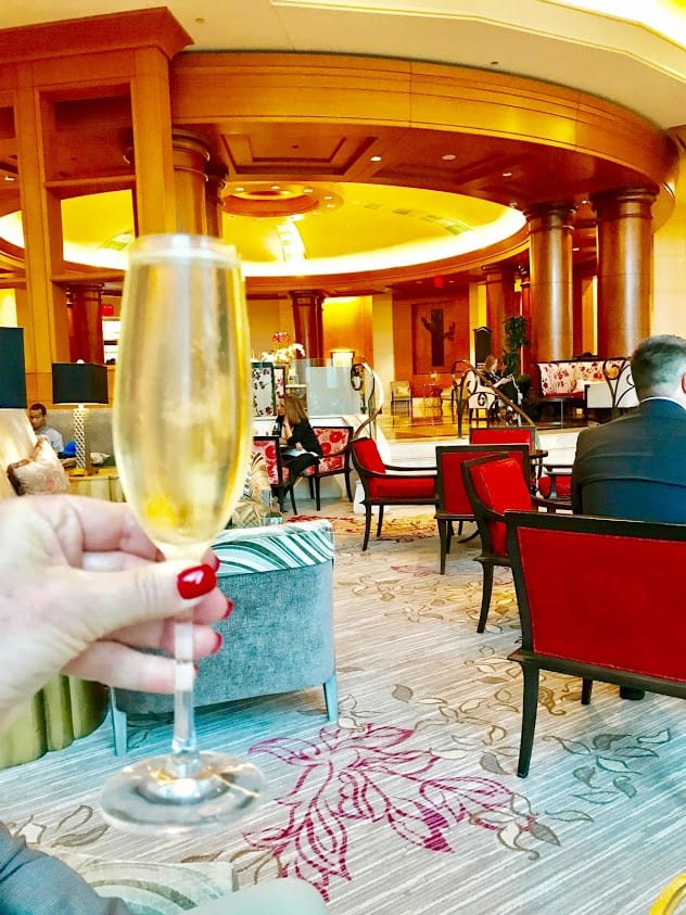 Enjoying a complimentary Champagne